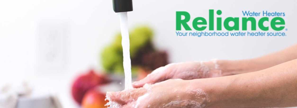 Reliance logo with kitchen faucet in background - Your Neighborhood water heater source